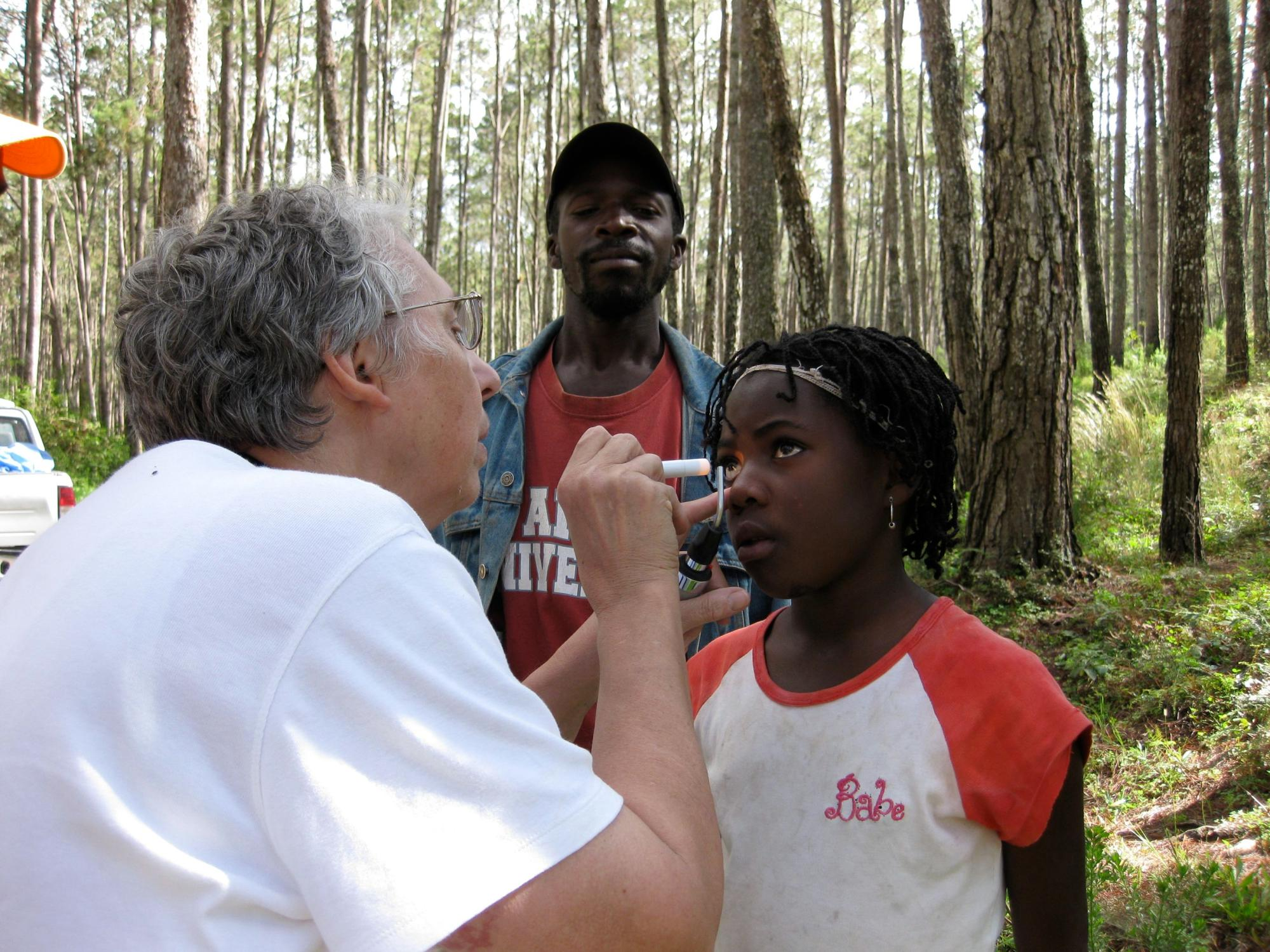 Dr10658._Martha_Willi_doing_eye_exam_in_Pine_Forest_while_car_being_repaired_0060_JPG.jpg
