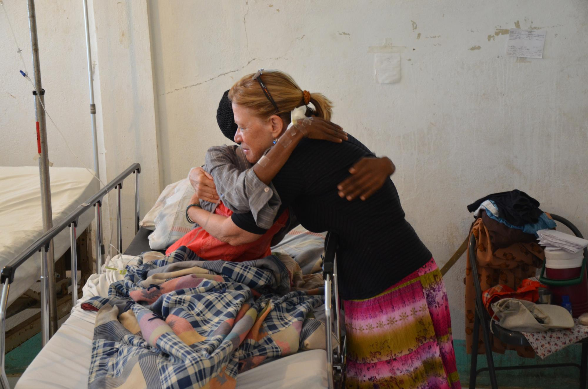 Haiti2013_Jane_compassion_w_pt_Juna_eye_diabetic_post_surg___727.jpg