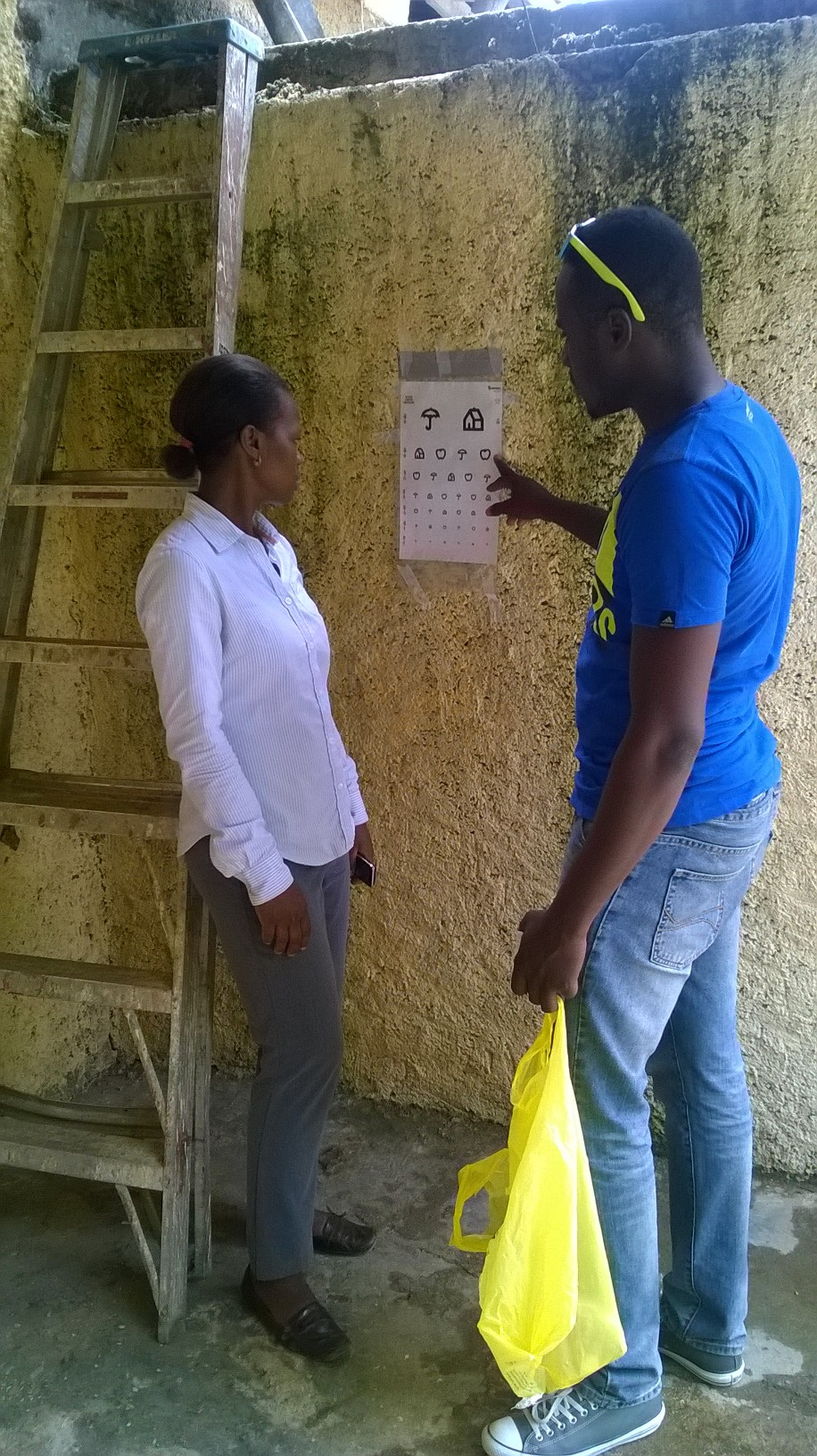 Miss_Jeanette_Labenture_from_Bodarie_National_Health_Center_receiving_instructions_from_Assistant_Ericsson_a_graduate_from_University_of_Guyana_August_25_15_WP_20150825_008.jpg