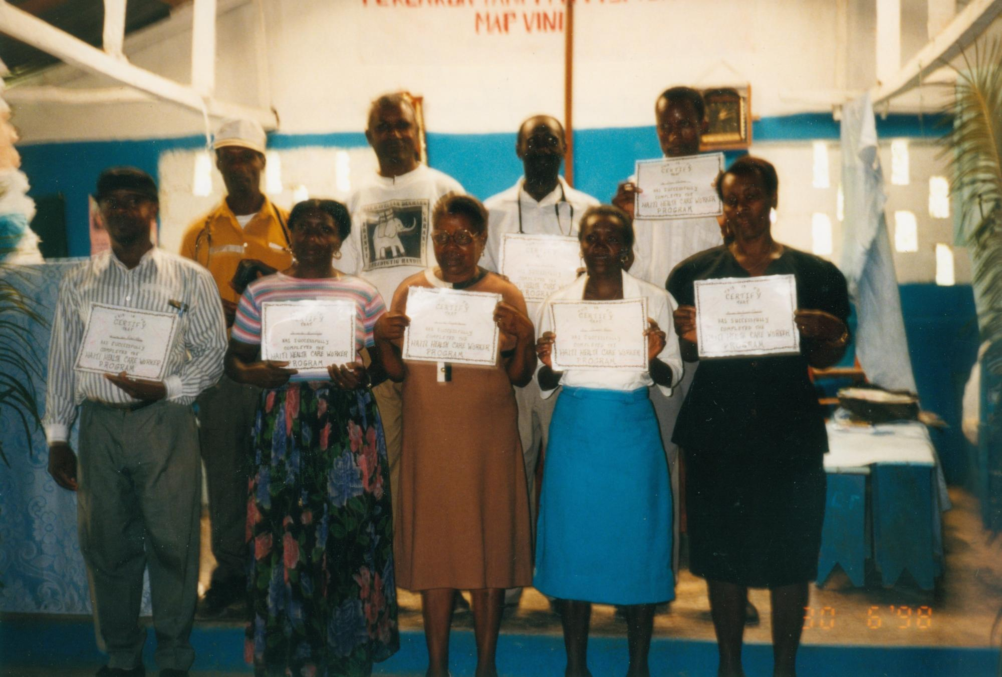 Thiotte_health_care_workers_display_certificates_for_course_Where_There_is_No_Doctor_1998_Maureen_image6.jpg
